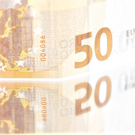 blurred euro money background and mirror like concept of success prosperity and business