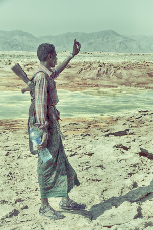 ETHIOPIA,DANAKIL-CIRCA  JANUARY 2018--unidentified  irregular soldier looking at the state boarder