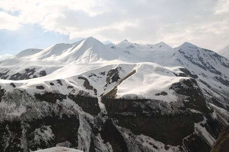in georgia kazbegi the mountain  and the monument in the caucasus