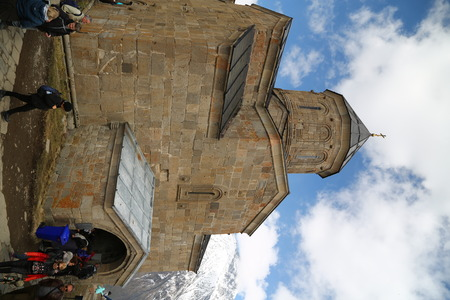 GEORGIA, GERGETI-CIRCA MAY 2019--unidentified people near the antique chatedral Editorial