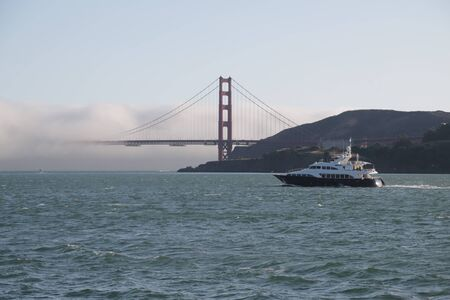 in USA san francisco the famous  golden bridge and the fog Reklamní fotografie