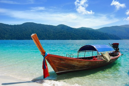 Longtail boat at the beach, Rawi island, Thailand photo
