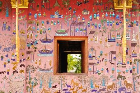 wat: Glass mosaic at wat xieng thong temple wall, Luangprabang,Laos