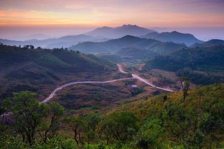 Landscape of sunrise over mountains in Kanchanaburi,Thailand photo
