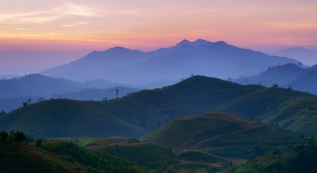 Landscape of sunrise over mountains in Kanchanaburi,Thailand photo