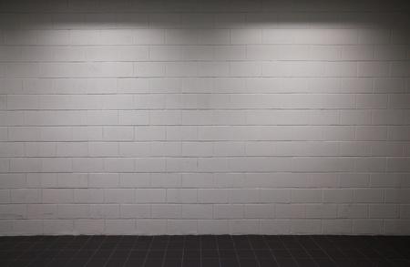 white brick wall with dim lighting  Banco de Imagens