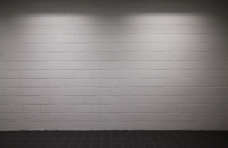 white brick wall with dim lighting  photo