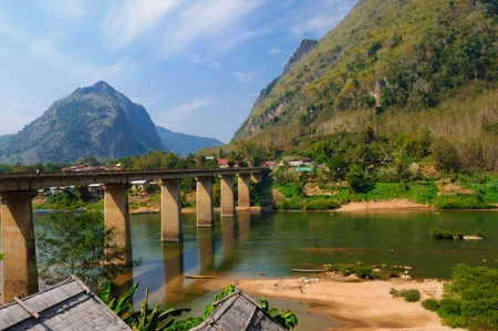 bridge over water: Nong khiaw mega Bridge, Nong Khiaw, Laos Stock Photo