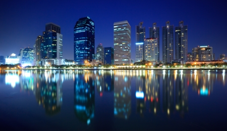 Panorama of Bangkok city at night with reflection of skyline, Bangkok,Thailand