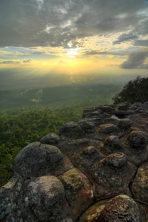 HDR landscape of mountain cliff at sunset photo
