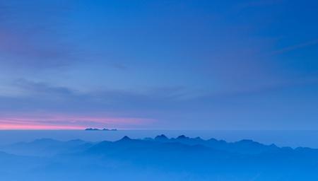 Morning Mist at Tropical Mountain Range at sunrise, Chiangmai,Thailand photo
