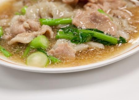 Guaitiao Rad Na (Wide Noodles in a Creamy gravy Sauce), Thai style food Banco de Imagens