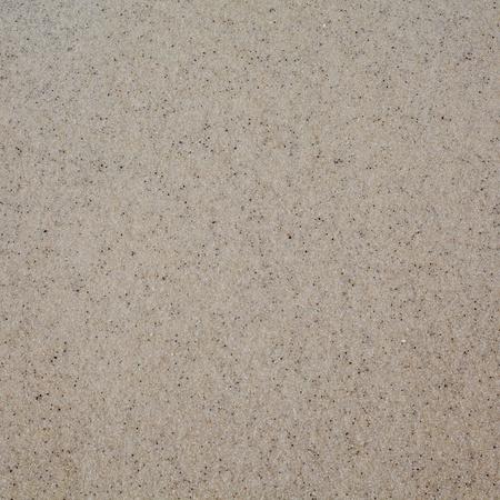Fine grain wet beach sand texture background photo