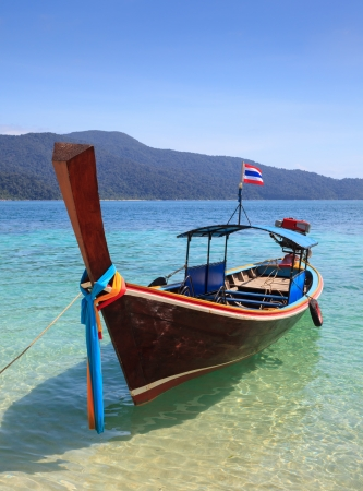 longtail: long tail boat sit on the beach, Rawi island, Thailand