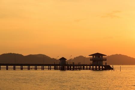 Bridge to the sea at sunset, Songkhla, Thailand photo
