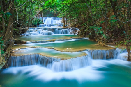 flowing: Deep forest Waterfall in Kanchanaburi, Thailand