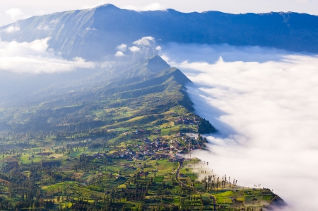 Village and Cliff at Bromo Volcano in Tengger Semeru national park, Java, Indonesia photo