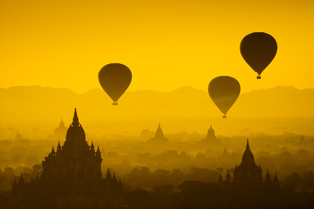 top of the world: Hot air balloon over plain of Bagan in misty morning, Myanmar