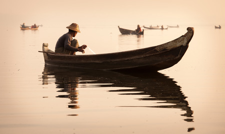Fishermen in Mandalay at sunrise, Mandalay, Myanmar photo