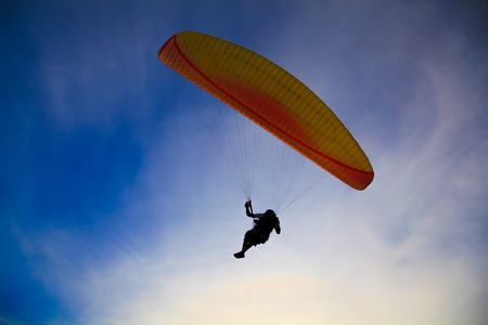 Paragliding   Silhouette on blue sky backlight background