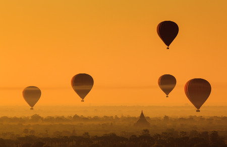 Hot air balloon over plain of Bagan in misty morning, Myanmar photo