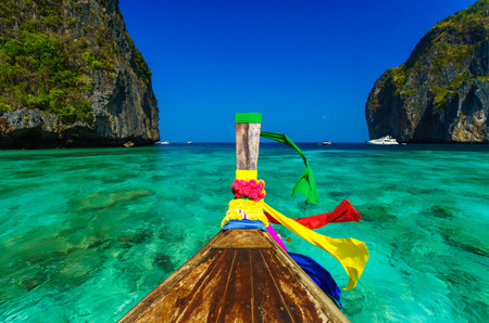 Traditional longtail boat in Maya bay on Koh Phi Phi Leh Island, Krabi, Southern of Thailand photo