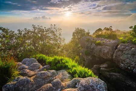 hin: Sunset at mountain peak Phu Hin Rong Kla National Park north of  Thailand Stock Photo