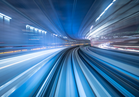 railway transportations: Motion blur of train moving inside tunnel in Tokyo, Japan