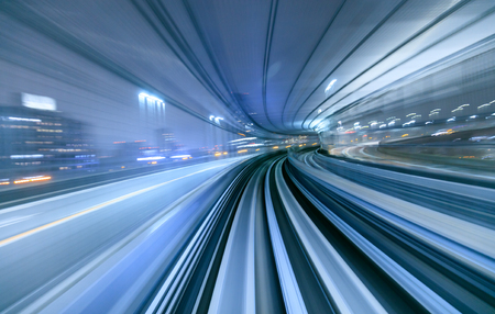 subway station: Motion blur of train moving inside tunnel in Tokyo, Japan