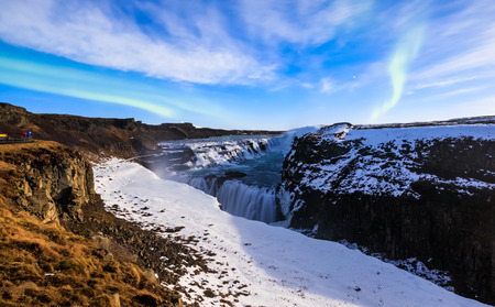 northern light: Gullfoss waterfall with Aurora borealis at night in full moon light, Iceland
