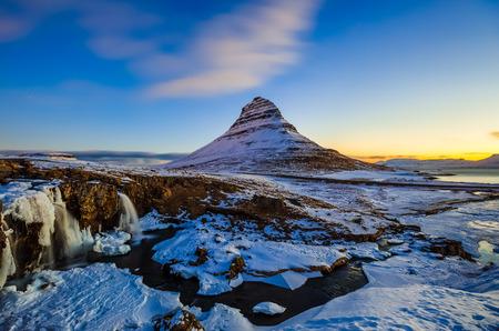 winter sunrise: Kirkjufellsfoss Waterfall with Kirkjufell mountain at sunrise, Iceland
