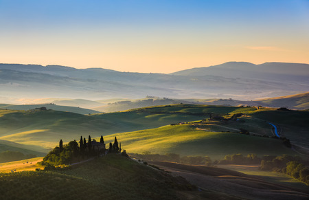 The rolling hills and green fields at sunrise, Tuscany, Italy