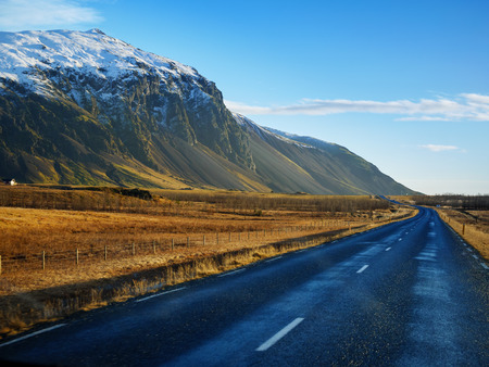 Curve raod to the mountain with motion blur, Iceland Stock Photo