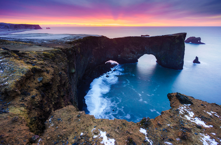Sunrise over Sea arch at Dyrholaey peninsula , Iceland