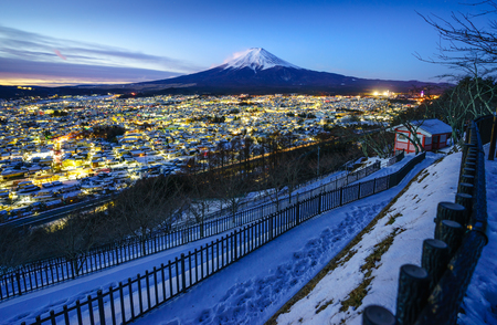 Mt Fuji and Fujiyoshida city at twilight, Japan Banco de Imagens