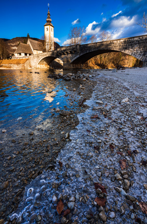 Church of St John the Baptist in winter season, Lake Bohinj, Slovenia