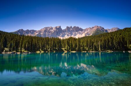 Karersee lake in the Dolomites, South Tyrol, Italy