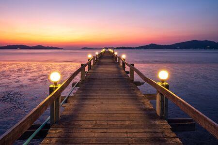 Wooden bridge of Chan Damri Beach at sunset ,Ranong ,Thailand