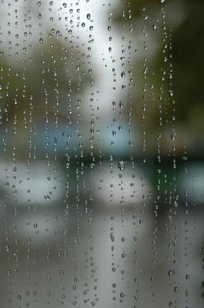 Rain drops on glass door from indoor Stock Photo
