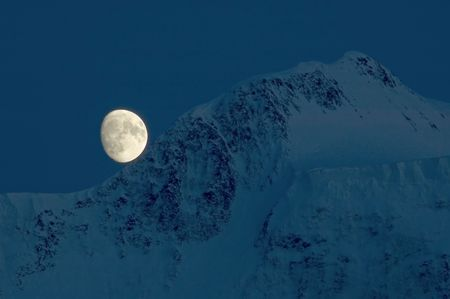 Moon over Belukha Peak, 4506 meters over sea level, Altay, Russia