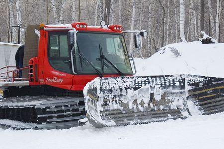 bulldoze: Ski slope servise is caterpillar snowplow. Ural Mountains. Russia