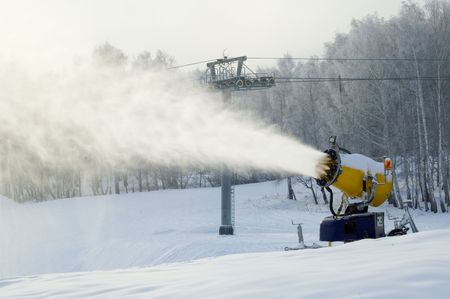 Working snow cannon and ski lifting line Stock Photo