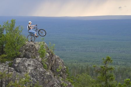 Biker at Oldman-Stone peak, Sverdlovskaya region of Russia