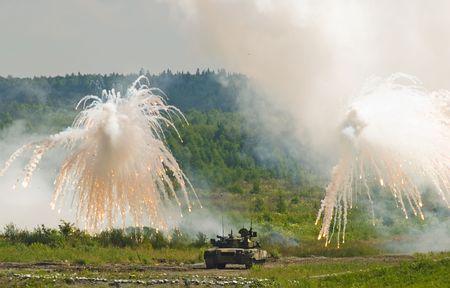 Russian tank T-80 making smoke screen from enemy photo