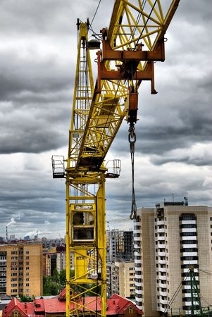 Lifting crane on construction site in Tyumen, Russia photo