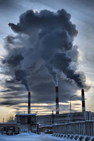 City power plant and smoke from pipe in winter season