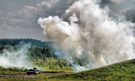 unstoppable: Russian tank between smoke screen