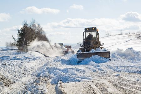 Snowplow removing snow from intercity road from snow blizzard photo