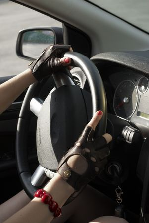Driving girl with hands on wheel steering photo