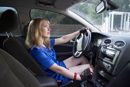 levers: Driving girl with hand on speed lever